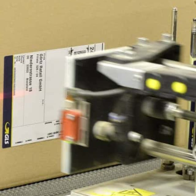Labels Applied to Cartons Via TampBlow Process